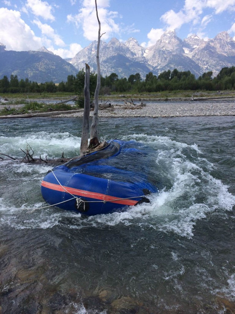 A raft hung up on a snag in the Snake River near Bar BC Ranch. National Park Service Photo.